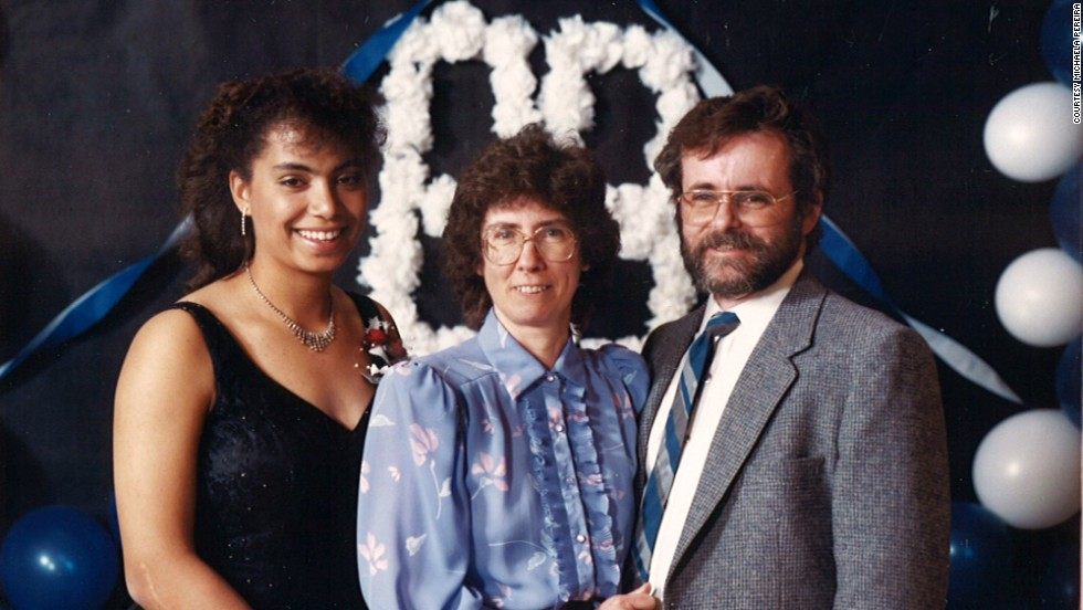 Pereira poses with her parents, Doug and Ainslie, for her high school graduation.