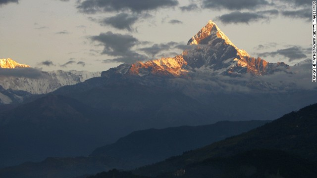 (FILES) In this photograph taken on November 1, 2010, Mount Machhapuchhre, which stands at 6993 metres and forms part of the Annapurna region, is seen from Pokhara, some 200kms west of the Nepalese capital Kathmandu. A snowstorm and avalanche in Nepal's Himalayas has killed nine trekkers -- eight foreign and one local -- on a popular hiking circuit, while more than 100 others remain out of contact, officials said October 15. AFP PHOTO/Prakash MATHEMA/FILESPRAKASH MATHEMA/AFP/Getty Images