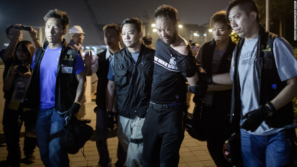 Pro-democracy demonstrator Ken Tsang gets taken taken away by police before allegedly being beaten up in Hong Kong on October 15. Authorities have vowed to conduct an investigation into a widely circulated video that appears to show plainclothes officers kicking and punching the man.