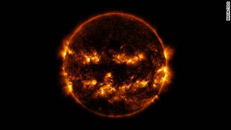 Active regions on the sun combined to look something like a jack-o-lantern's face on Oct. 8, 2014. The image was captured by NASA's Solar Dynamics Observatory, or SDO, which watches the sun at all times from its orbit in space. The active regions in this image appear brighter because those are areas that emit more light and energy.  They are markers of an intense and complex set of magnetic fields hovering in the sun's atmosphere, the corona. This image blends together two sets of extreme ultraviolet wavelengths at 171 and 193 Ångströms, typically colorized in gold and yellow, to create a particularly Halloween-like appearance. Credit: NASA/SDO