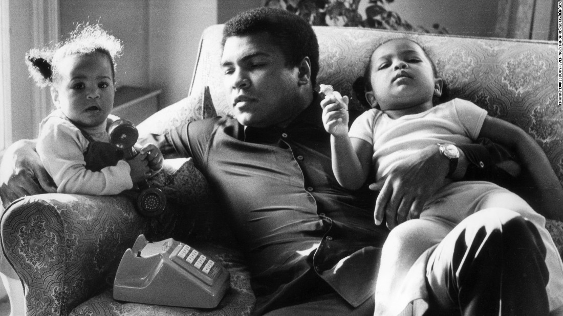 Ali sits with his daughters Laila and Hana at the Grosvenor House in London in December 1978. He briefly retired from professional boxing the following year.