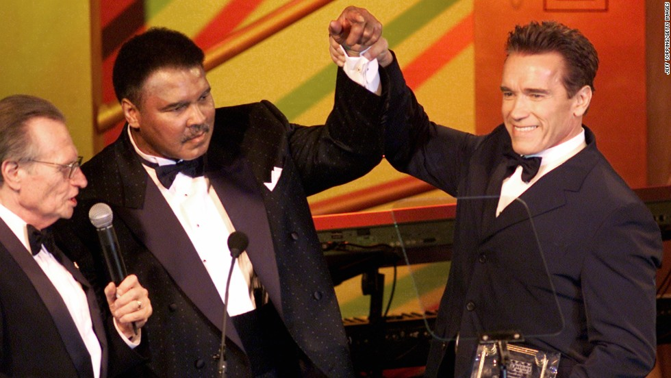Actor Arnold Schwarzenegger raises Ali's hand during the Celebrity Fight Night charity event in Phoenix in March 2002. Schwarzenegger was presented with the Muhammad Ali Humanitarian Award for his work with the Muhammad Ali Parkinson Research Foundation, the Inner-City Games Foundation and the Special Olympics. The award was presented by former CNN host Larry King, left.