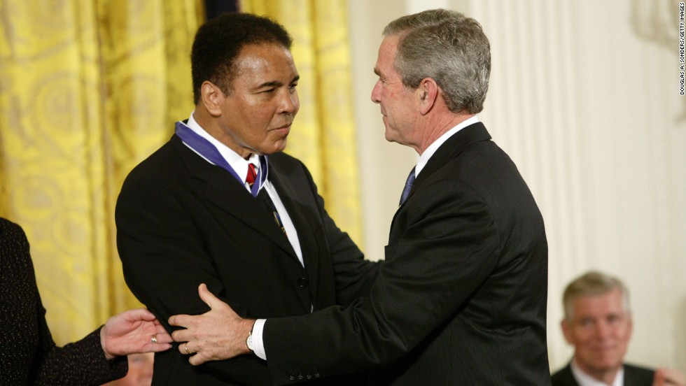 U.S. President George W. Bush presents Ali with the Presidential Medal of Freedom, the nation's highest civilian honor, on November 9, 2005.