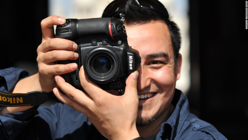 "Kurbanjan Samat, 32, is a cameraman and photographer. He started a project called ""I'm from Xinjiang"" last December to take portraits of people from Xinjiang now living in other places. He's publishing a book of 100 stories selected from more than 500 people he spoke to."