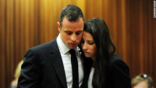 Oscar Pistorius with his sister Aimee on the thirteenth day of his trial for the murder of his girlfriend Reeva Steenkamp at the North Gauteng High Court in Pretoria on March 19, 2014.