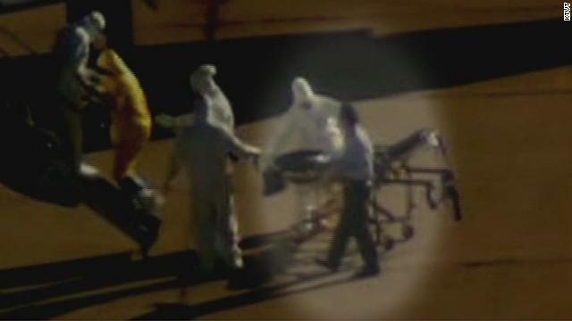 ath cohen clipboard man with ebola nurse_00000516.jpg
