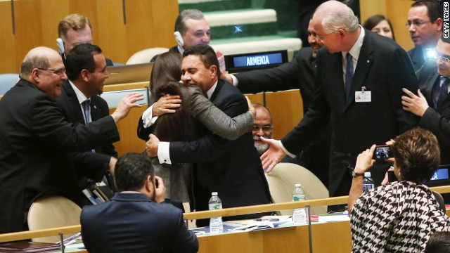 NEW YORK, NY - OCTOBER 16: UN representatives for Venezuela, including Foreign Minister Rafael Ramrez (R) celebrate after being elected to a two year term as a non-permanent member of the United Nations Security Council following secret voting at the United Nations General Assembly on October 16, 2014 in New York City. Malaysia, Venezuela and Angola were running unopposed for their three regional seats while the other two seats are for the Western Europe and Others group with the candidates being Turkey, Spain and New Zealand. The Security Council has 15 members, five of which are permanent and 10 non-permanent. The 10 non permanent members of the council are elected on a regional basis and serve two-year terms. (Photo by Spencer Platt/Getty Images)