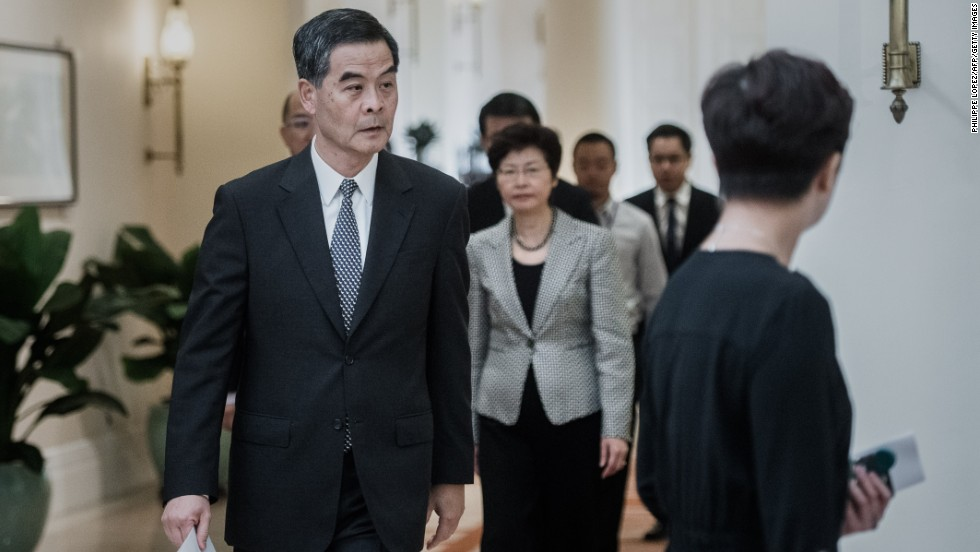 Hong Kong Chief Executive C.Y. Leung arrives for a news conference on October 16. He said talks would resume with students as early as next week, but he said street protests had caused severe disruption and could not continue.