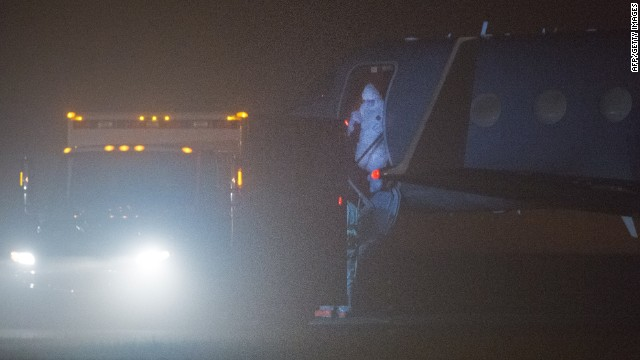 Nina Pham, 26, the first person infected with Ebola in the United States, steps off the plane October 16, 2014 during a transfer at Frederick, Maryland.
