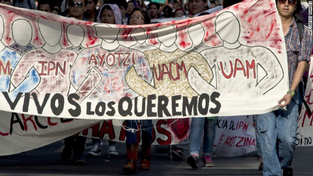 Students march along Reforma Avenue in front of the Attorney General's Office on October 15, 2014 in Mexico City, during a protest supporting the 43 students missing in Iguala, Guerrero State. The mystery over the fate of 43 Mexican students missing since an attack by gang-linked police deepened after authorities said none was among 28 bodies found in a mass grave. AFP PHOTO/OMAR TORRESOMAR TORRES/AFP/Getty Images