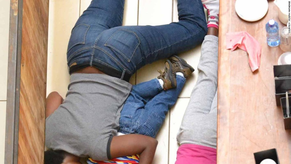 In this photograph from Mathenge, a mother and her two children lie face down on the floor pretending to be dead during the nightmare attacks at Nairobi's upscale shopping mall last year.