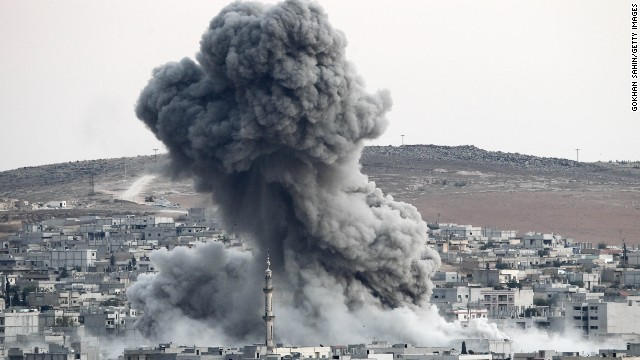 Heavy smoke rises following an airstrike by the U.S.-led coalition aircraft in Kobani, Syria, during fighting between Syrian Kurds and the militants of Islamic State group, as seen from the outskirts of Suruc, on the Turkey-Syria border, October 18.