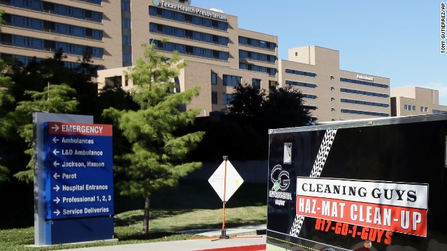 A trailer with Hazardous Materials signage being pulled by a truck drives past Texas Health Presbyterian Hospital Dallas on its way to the the loading docks nearby, Thursday, Oct. 16, 2014, in Dallas. (AP Photo/Tony Gutierrez)