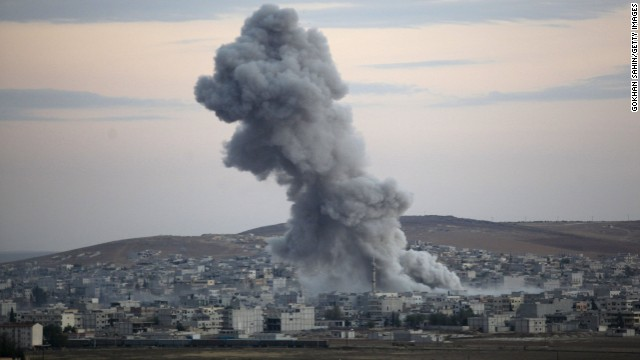 Caption:SANLIURFA, TURKEY - OCTOBER 18: (TURKEY OUT) Heavy smoke rises following an airstrike by the US-led coalition in Kobani, Syria, during fighting between Syrian Kurds and the militants of Islamic State group, as seen from the outskirts of Suruc, on the Turkey-Syria border, October 18, 2014. Kurdish fighters in Syrian city of Kobani have pushed back Islamic State militants in a number of locations as U.S. airstrikes on ISIS positions continue in and around the city. Since mid-September more than 200,000 people from Kobani flee into Turkey. (Photo by Gokhan Sahin/Getty Images)