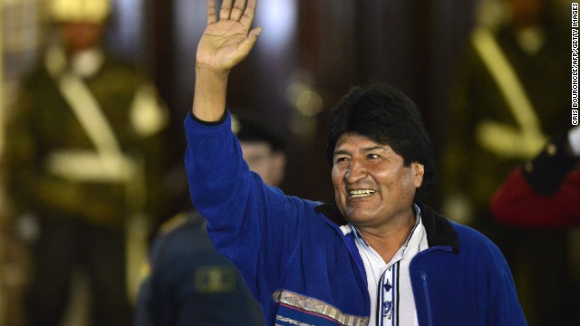 Virtually re-elected Bolivias President Evo Morales salutes sympathizers gathered in the Plaza Murillo upon his arrival to the Presidential Palace in La Paz, celebrating his victory after the partial results of the presidential election on October 12, 2014 were disclosed. Bolivians voted Sunday in elections widely expected to give indigenous President Evo Morales a third term in office, along with a legislative majority needed to push through his leftist reforms. AFP PHOTO/CRIS BOURONCLE (Photo credit should read CRIS BOURONCLE/AFP/Getty Images)