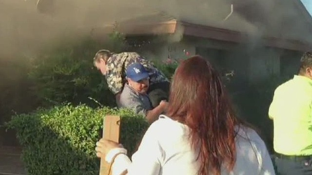 pkg mystery man rescues person from house fire_00002428.jpg