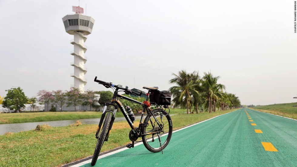 More than 15 miles long, the traffic-free, green tarmacked loop around Bangkok's Suvarnabhumi Airport is free. You only need to show ID to pedal in.