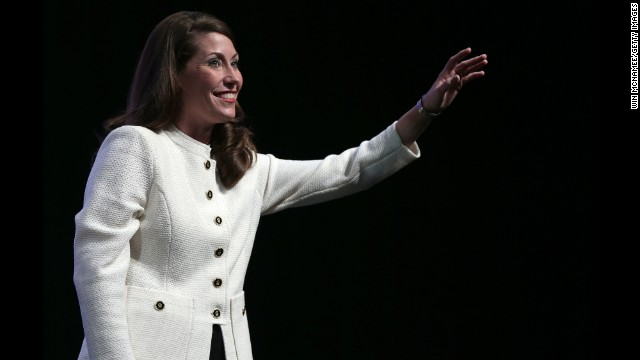 LOUISVILLE, KY - OCTOBER 15:  U.S. Senate Democratic candidate and Kentucky Secretary of State Alison Lundergan Grimes waves to supporters at a rally where she campaigned with former U.S. Secretary of State Hillary Clinton on October 15 in Louisville, KY.