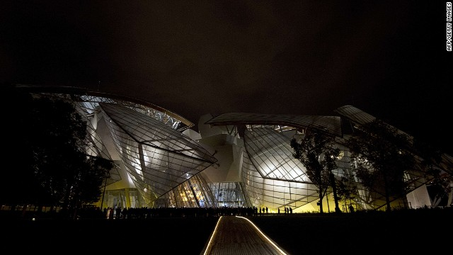 "A picture taken on October 20, 2014 shows the Louis Vuitton art museum during its inauguration, a week before its official opening to the public, on October 20, 2014 on the edge of the Bois de Boulogne park, in Paris. The private contemporary art museum was financed by Bernard Arnault, who heads up the LVMH luxury goods empire and whose net worth is estimated at almost $30 billion (23 billion euros) by Forbes. The foundation was designed by 85-year-old architect Frank Gehry who wanted to ""design, in Paris, a magnificent vessel symbolising the cultural calling of France"". AFP PHOTO/ ALAIN JOCARDALAIN JOCARD/AFP/Getty Images"