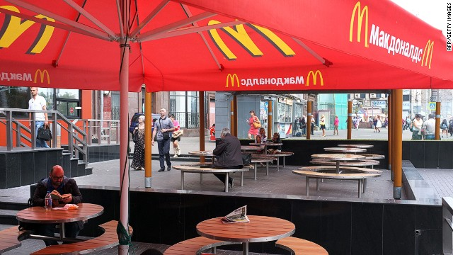 A man reads a book as he sits at a table of a closed McDonald's restaurant, the first to be opened in the Soviet Union in 1990, in Moscow on August 21, 2014. Russian authorities shuttered four Moscow McDonald's due to alleged sanitary violations on August 20, 2014, including a restaurant that once symbolised reviving Soviet-US ties, as tensions sizzled over Ukraine. The announcement comes in the wake of Russian bans on US and EU food imports in response to Western sanctions over Moscow's perceived backing for rebels in eastern Ukraine.  AFP PHOTO / ALEXANDER NEMENOVALEXANDER NEMENOV/AFP/Getty Images