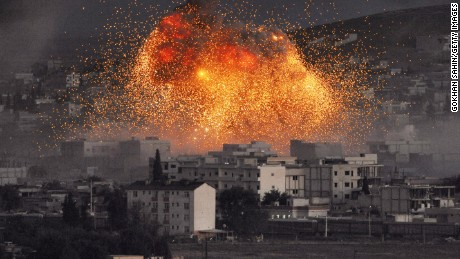 An explosion rocks Kobani, Syria, during a reported suicide car bomb attack by ISIS militants on Monday, October 20.