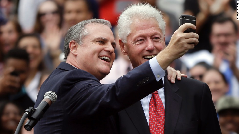Pryor takes a selfie with former President Bill Clinton at a political rally last month at the University of Central Arkansas. The incumbent tried to distance himself from Obama in an effort to keep rallying supporters in the red state.