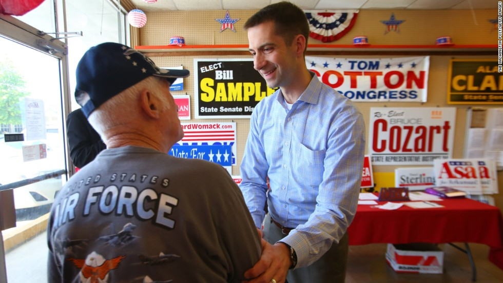 Cotton greets George Edwards, left, after addressing a crowd of supporters at a Republican headquarters office in Hot Springs, Arkansas, in April.