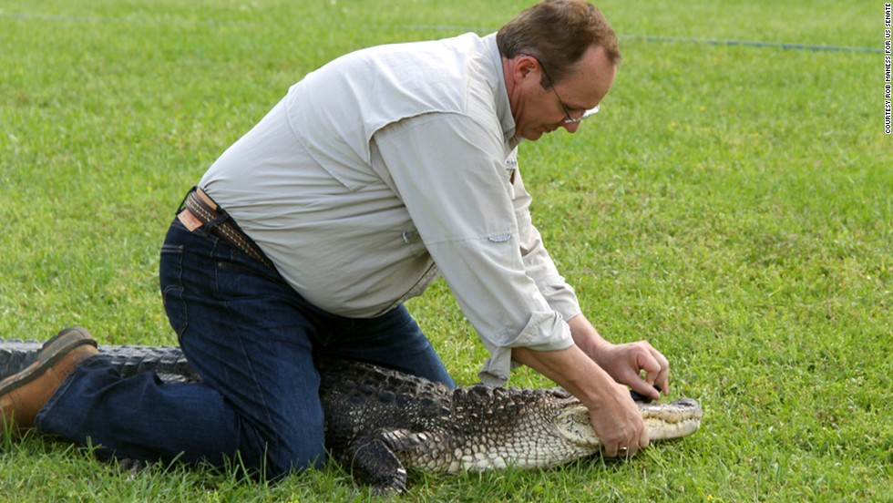 Maness sits on an alligator while shooting a campaign commercial in May.