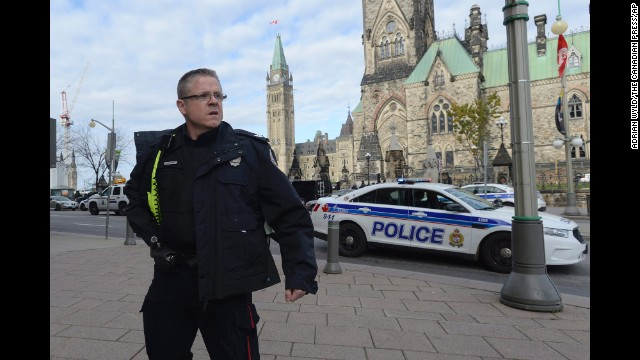 A police officer secures the scene of a shooting on Parliament Hill in Ottawa on October 22.