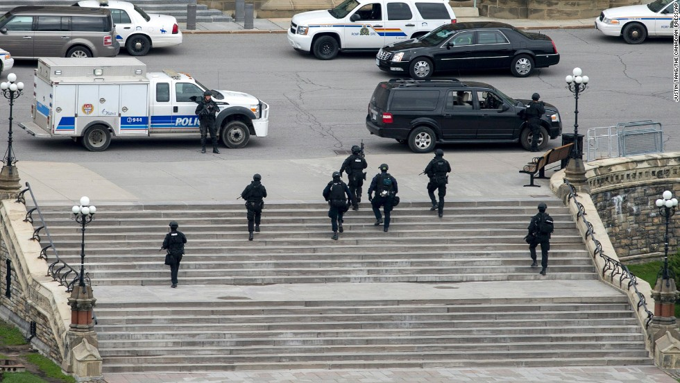 Police move toward the Parliament building.