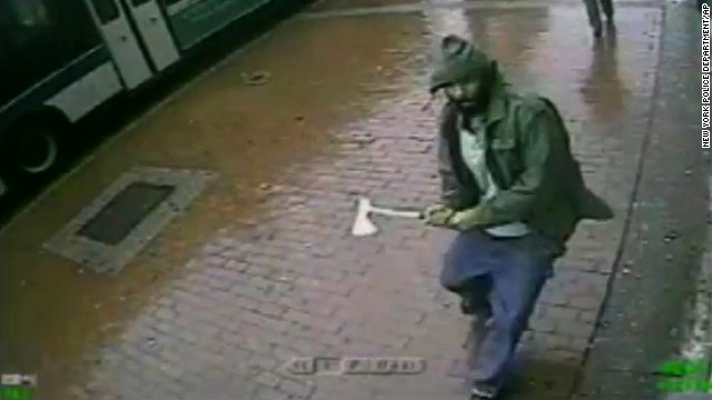 In this frame grab taken from video provided by the New York Police Department, an unidentified man approaches New York City police officers with a hatchet, Thursday, Oct. 23, 2014, in the Queens borough of New York. The man injured two with the hatchet before the other officers shot and killed him, police said. A bystander was wounded in the gunfire. Investigators were still trying to confirm the identity of the assailant and determine a motive. (AP Photo/New York Police Department)