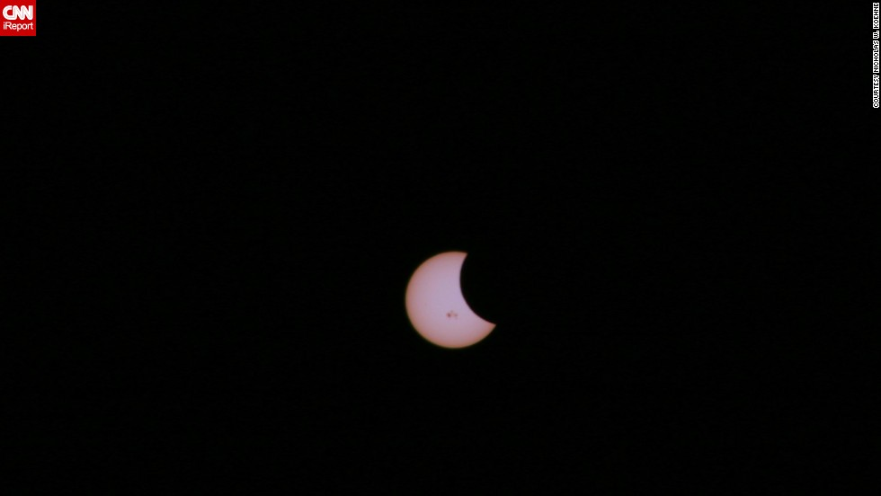 "For more than an hour, engineer <a href=""http://ireport.cnn.com/docs/DOC-1182662"">Nicholas Koehne</a> waited to photograph the partial solar eclipse in Topeka, Kansas. Using a solar filter, he was able to capture several images of the event."