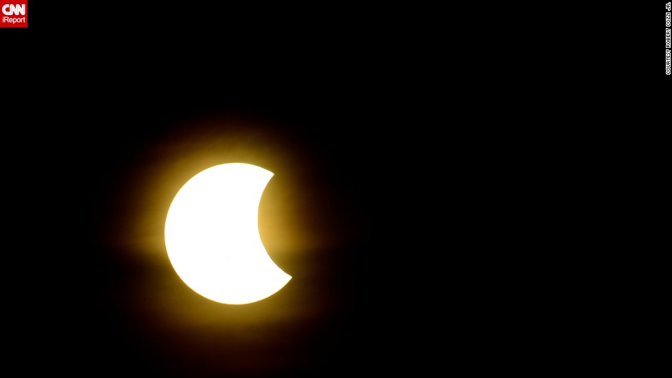 "Stacking multiple polarizing filters onto his camera lens, <a href=""http://ireport.cnn.com/docs/DOC-1182507"">Bob Cozzi</a> captured the bright partial solar eclipse from his home in North Aurora, Illinois."