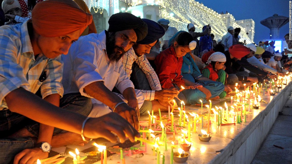 Indian Sikhs celebrate Diwali to mark the return of the sixth Guru, Hargobind Ji, who is said to have released 52 political prisoners while being freed from his own imprisonment from Gwalior Fort by Mughal Emperor Jahangir in 1619.