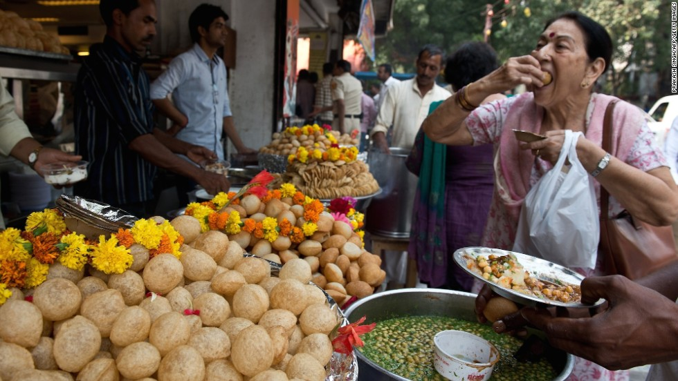 Diwali is also a time for exchanging gifts -- traditionally sweets and dried fruit, which are in abundance on the streets in the run up to the festival. Here, a woman samples some gol gappas at a roadside snack shop in New Delhi.