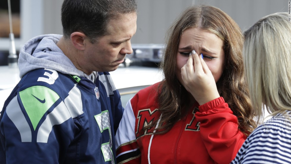A girl is consoled at the church after the shooting.