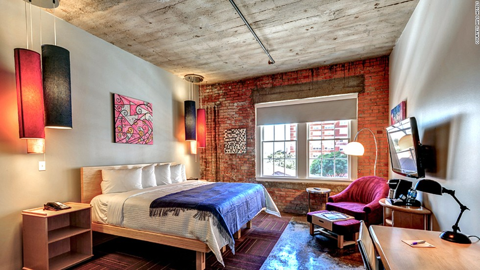 The NYLO Dallas South Side hotel is located in a former Sears warehouse dating to 1911. All loft-style guestrooms have details such as exposed brick walls, high ceilings and concrete floors.