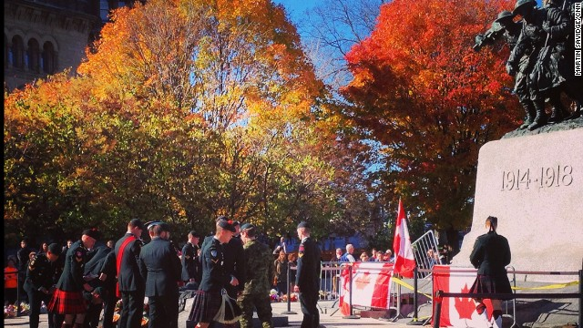 OTTAWA, CANADA:  Soldiers place floral tributes around National War Memorial where honor guard was slain Wednesday.  Photo by CNN's Martin Savidge, October 24.  Follow Martin (@martinsavidge) and other CNNers along on Instagram at instagram.com/cnn.