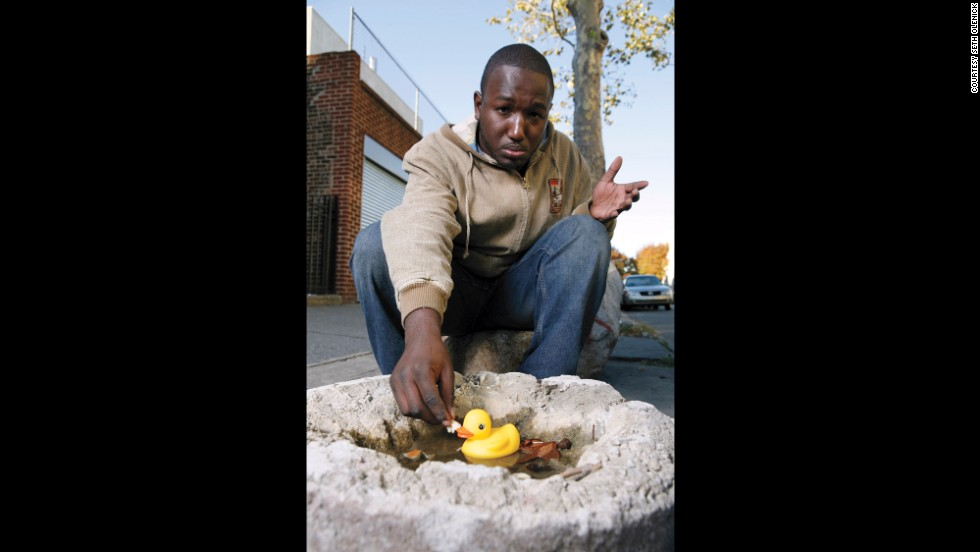 "<strong>Hannibal Buress: </strong>""Ducks mean a lot in American society. How did ducks become the premiere bird to rubberize and have in the tub with you as you bathe? Why wasn't I afforded the opportunity to bathe with rubber bald eagles or rubber flamingos? This picture shows how ducks have become very arrogant, I tried to give the duck bread, and it didn't want to take it. It made me sad, but I got over it. Seth captured that moment.""<br />"