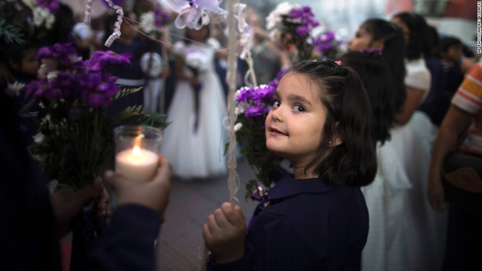 "OCTOBER 27 - MADRID, SPAIN: A girl takes part in the ""Senor de los Milagros"" procession. Peruvians in Madrid gathered for the annual celebration of the ""Lord of Miracles,"" the patron saint of Catholic Peruvians."
