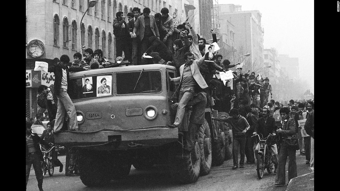 Demonstrators celebrating the Shah's departure flood the streets of Tehran on January 17, 1979.