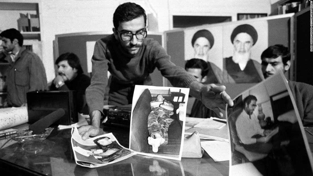 One of the student kidnappers presents pictures of the hostages during a news conference on November 8, 1979.