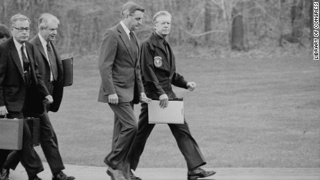 President Jimmy Carter, Vice President Walter Mondale, Secretary of State Cyrus Vance and Secretary of Defense Harold Brown disembark from their helicopter to meet about the Iran hostage crisis at Camp David in Maryland on November 23, 1979.