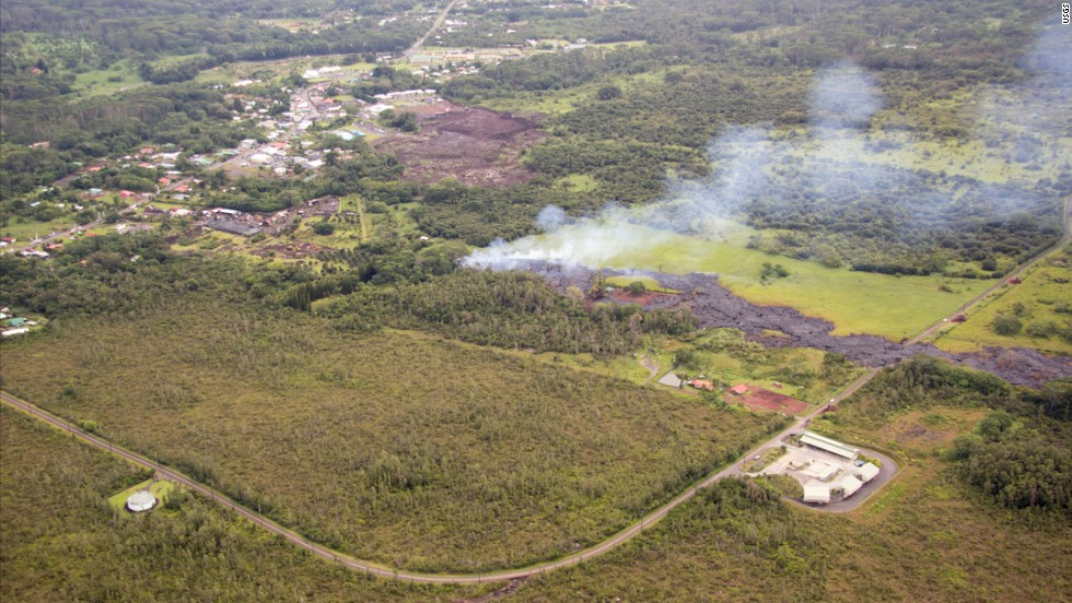 Smoke rises near Apa'a Street and Pahoa Village Road in Pahoa, Hawaii, on Monday, October 27.
