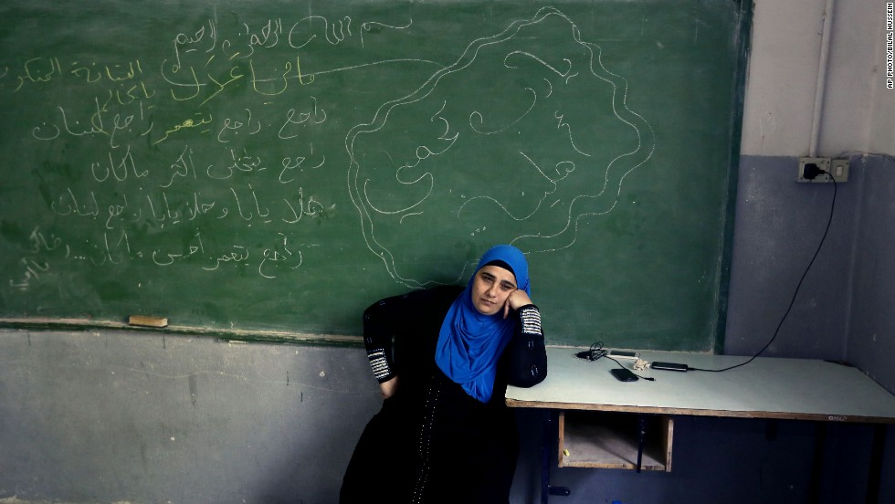 OCTOBER 28 - TRIPOLI, LEBANON: A refugee woman sits inside a school classroom. Lebanon is among the lowest ranking countries in a new report on the gender pay gap by the World Economic Forum. The report looks at economic opportunities, access to education and healthcare, and political empowerment.