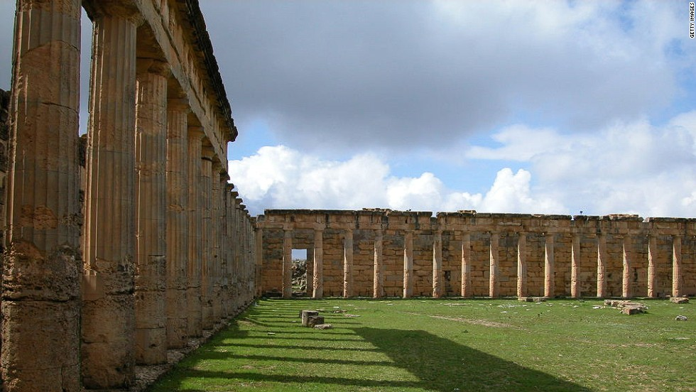 "A key city for the Greeks and Romans, established in 630 BC. Famed as the basis for enduring myths and legends, such as that of the huntress heroine of the same name and bride of Apollo. The ruins were some of the best preserved from that period, but in the wake of Libya's revolution, <a href=""http://www.thetimes.co.uk/tto/news/world/middleeast/article3856669.ece"" target=""_blank"">vast tracts have been bulldozed</a> including its unique necropolis complex."