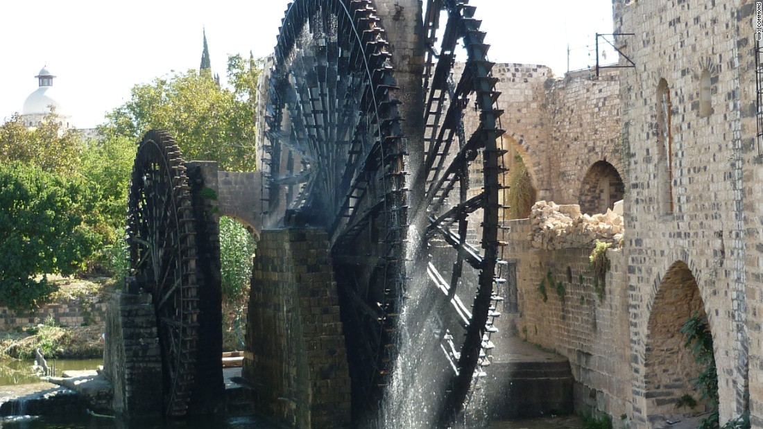 "These 20-meter wide water wheels were first documented in the 5th century, representing an ingenious early irrigation system. Seventeen of the wooden norias (a machine for lifting water into an aqueduct) survived to present day and became Hama's primary tourist attraction, noted for their groaning sounds as they turned. Heritage experts <a href=""http://www.dgam.gov.sy/index.php?p=314&id=1374"" target=""_blank"">documented several wheels</a> being burned by fighters in 2014."