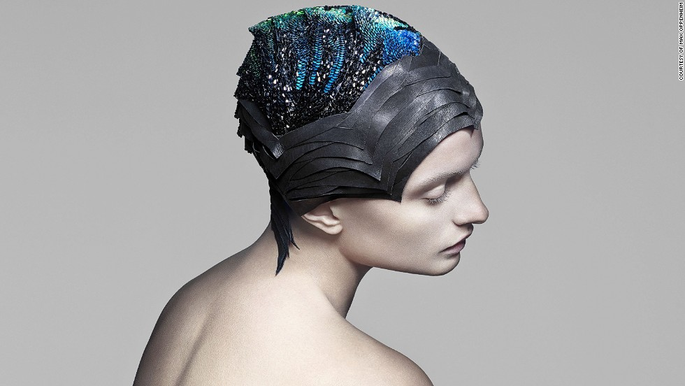 "<a href=""http://theunseenemporium.co.uk/"" target=""_blank"">The Unseen</a> have developed innovative textiles that change color in response to environmental stimuli, thanks to their unique dye formula. This headpiece, made of 4000 conductive Swarovski stones, changes color to correspond with localized brain activity."