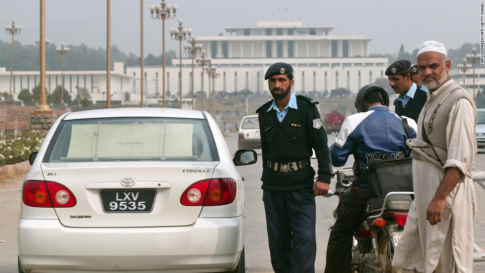 Pakistani police check a commuter's vehicle in front of the Aiwan-e-Sadr presidential palace in Islamabad on November 29, 2007.