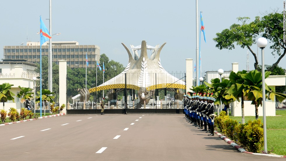 Presidential guards stand in front of the presidential palace of the Democratic Republic of Congo in the capital city of Kinshasa on May 22, 2013.